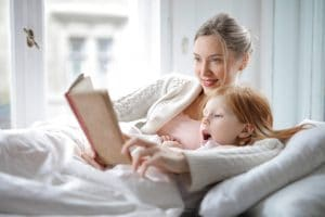 mother and daughter reading book with interest in bed 3755514 300x200 - 11 Good Bedtime Stories for Kids