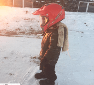 Photo By: Jennifer McFadden Taken @ the McFadden Family Farm in Deer River, MM – Gabe is bundled up and ready for his snowmobile ride.