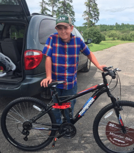 Photo By: Jennifer McFadden Taken @ the McFadden Family Farm in Deer River, MM – Sam Jr. is ready to take his bike for a spin.
