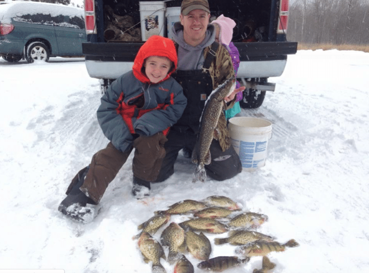Photo By: Jennifer McFadden Taken @ the McFadden Family Farm in Deer River, MM – Uncle Adam took Sam Jr. out for some angling through the ice on a local lake.
