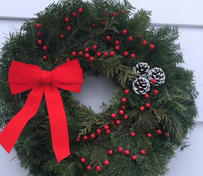 Photo By: Jennifer McFadden Taken @ Jens' Wreaths in Deer River, MM – Our oldest son, Sam Jr., came up with this new door wreath design.